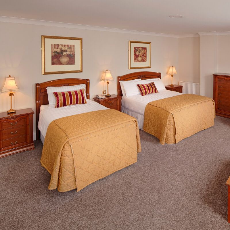 Royal Hotel and Merrill Leisure Club twin bedroom