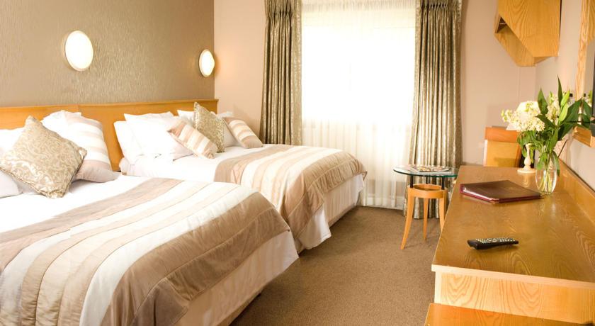 Great National Commons Inn Hotel Bedroom